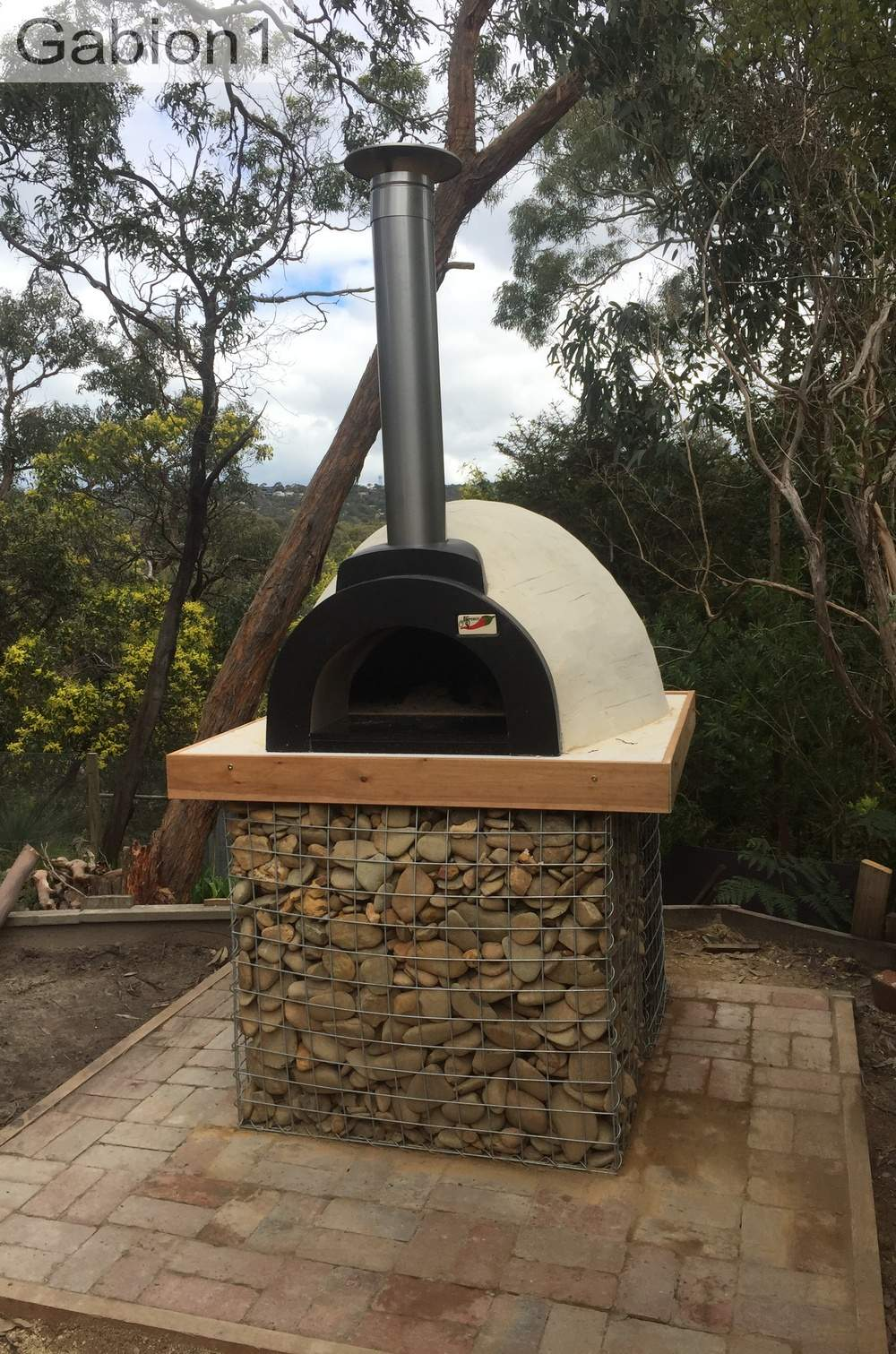 gabion base beneath pizza oven